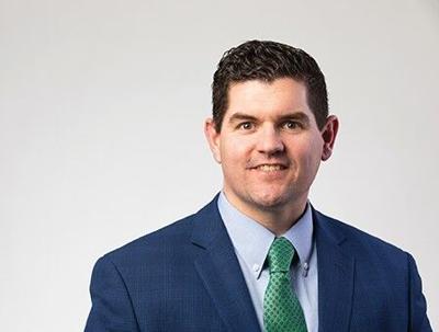Dr. Adam Metzler