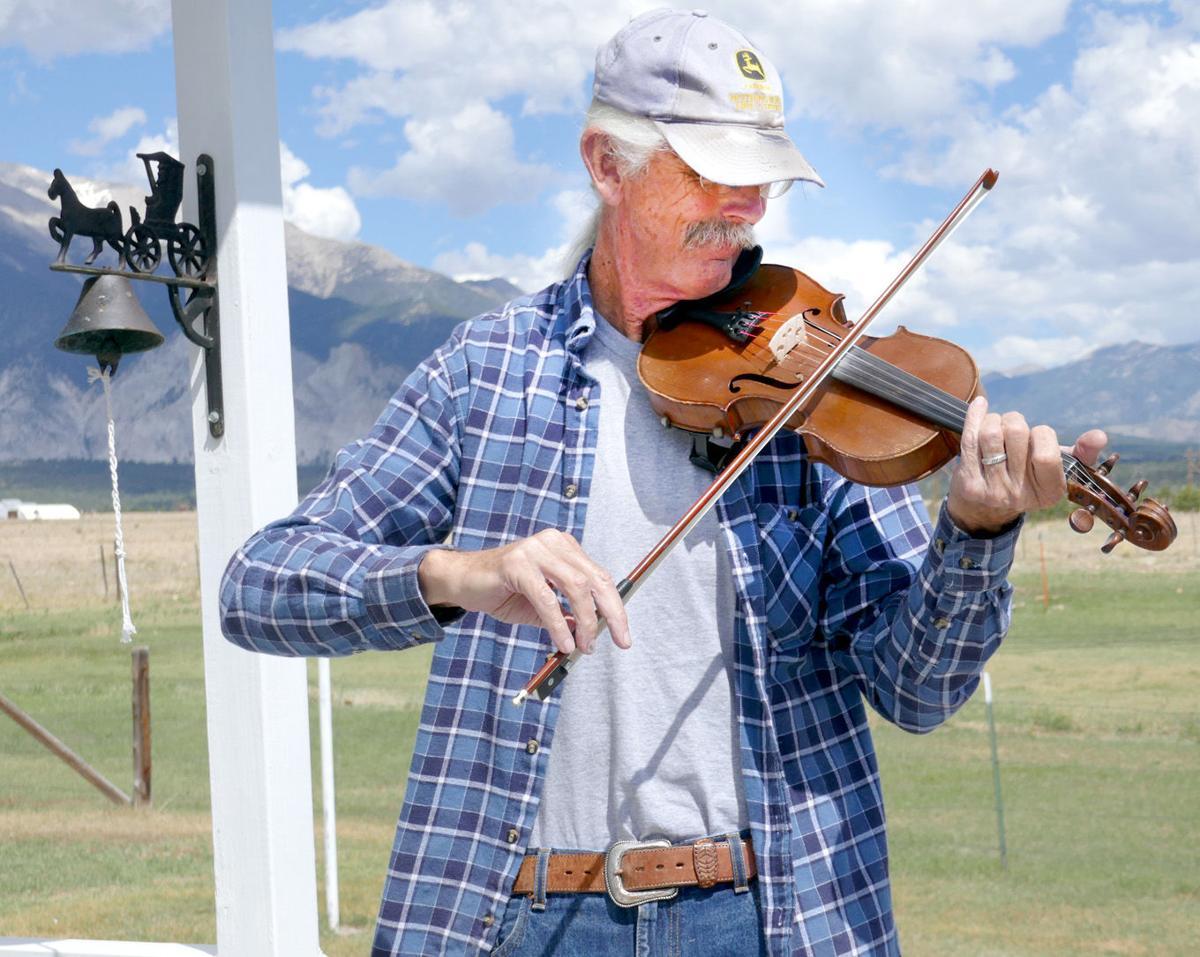 Dennis Fischer fiddles a tune