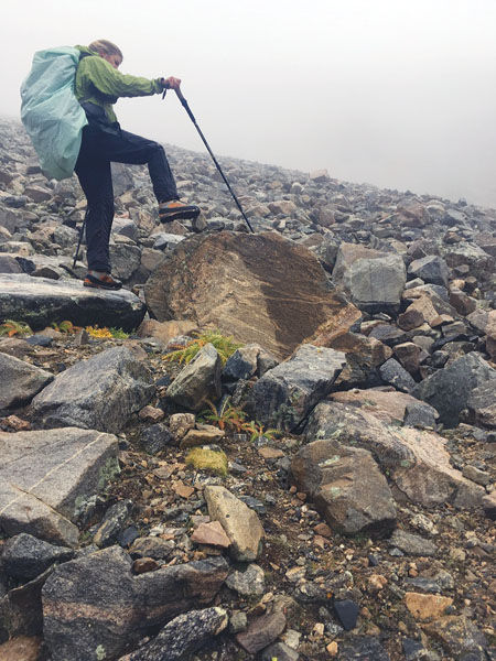 McEllhiney removes a cairn marking
