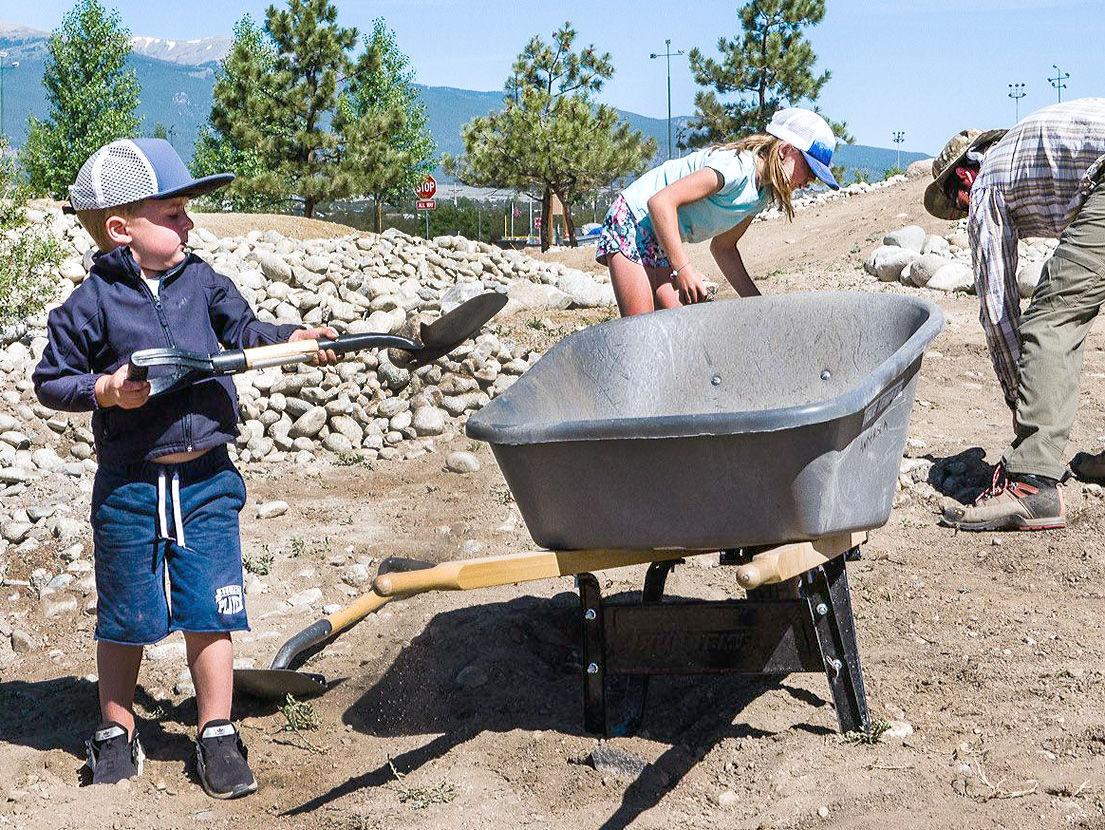 stone into wheelbarrow