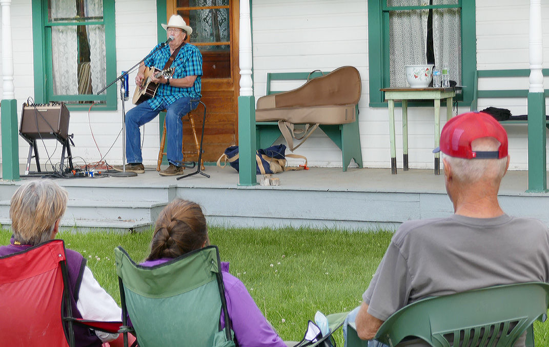 Gene Farrar plays guitar