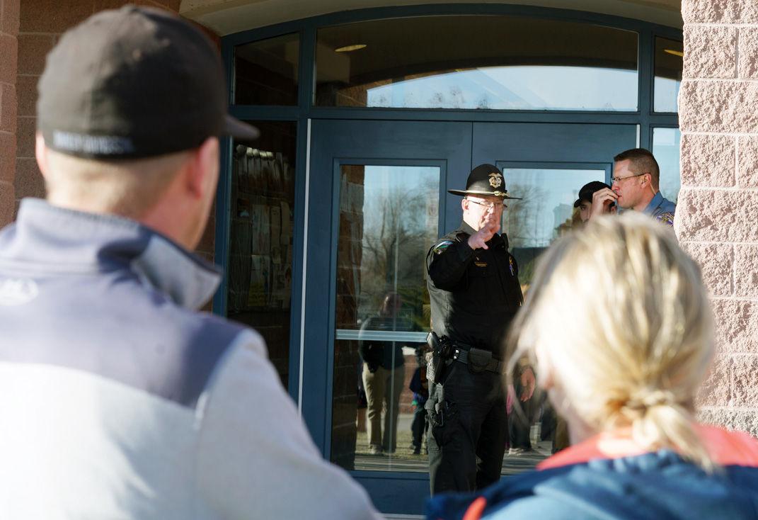 Chief Tidwell at school door