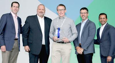 Lucas Smith accepts award