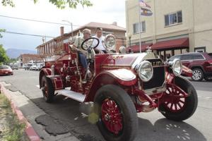 <p>Salida Fire Chief Doug Bess, right, and his stepfather, Jerry Henderson, a former Salida fire captain, take a seat in the restored 1911 Kissel fire truck. It was Salida's first mechanized fire truck. The previous equipment was a horse and hose cart.</p>