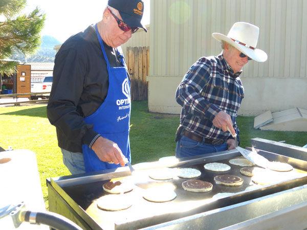 Baker flips pancakes