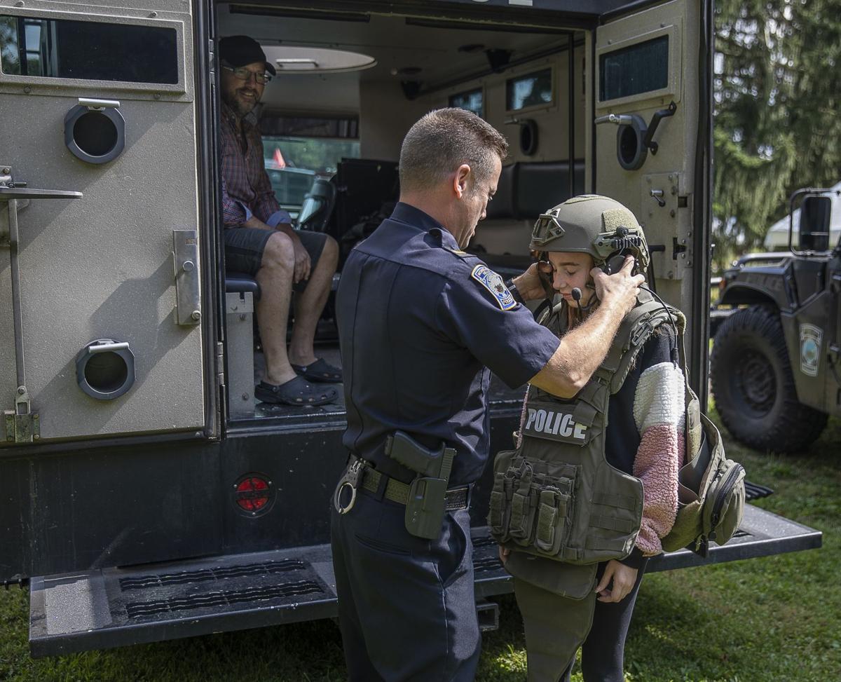 Lt. Todd Deitzel helps Grace Kidd