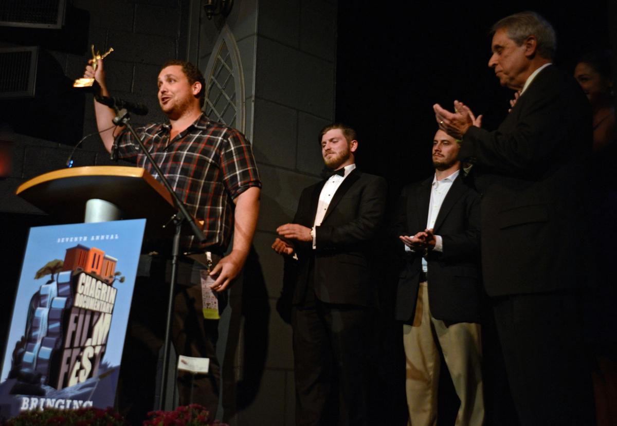 """Matthew Ornstein, director of """"Accidental Courtesy: Daryl Davis, Race & America"""" accepts the David Ponce Best of Fest award"""