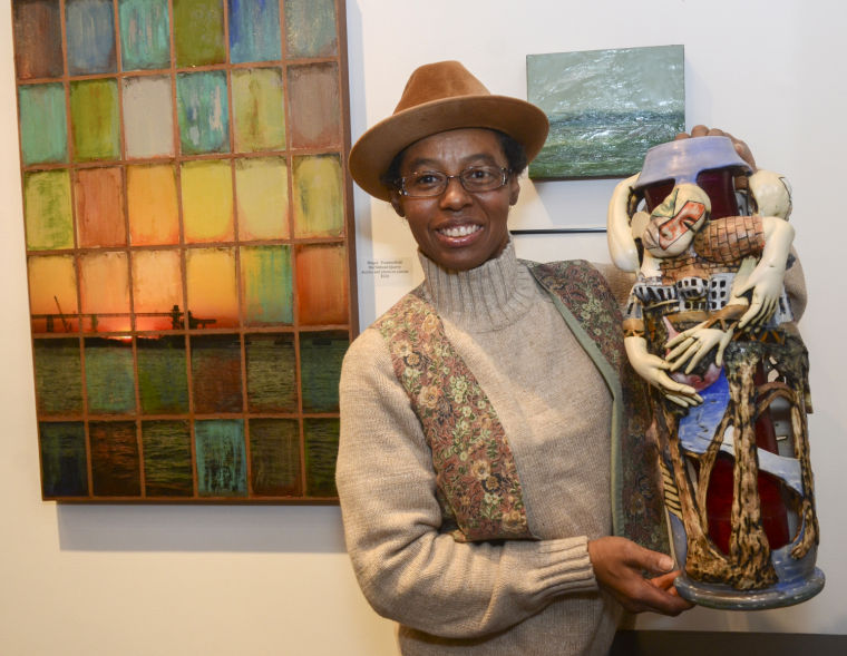 """Tracy Ameen holds her clay piece, """"The Untitled Woman"""" takes first place"""