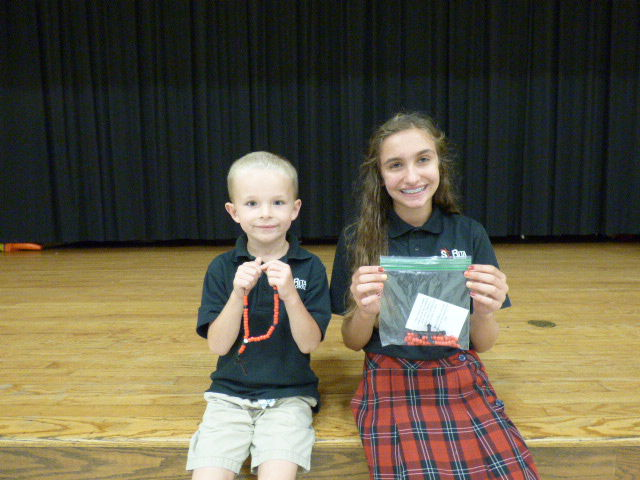 Students make rosaries for cathedral