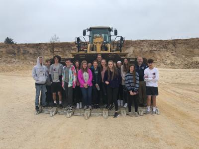 West G students stand on bulldozer
