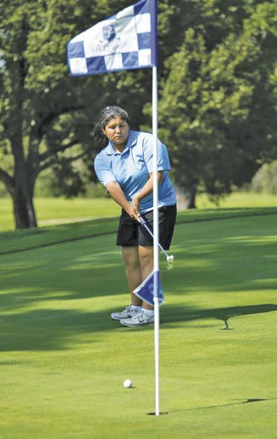 CHS' Lia Gutierrez putts on hole 8