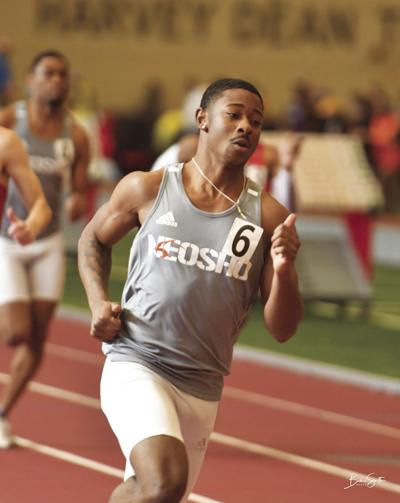 Caleb races around a track during the Region 6 Indoor Championship in Pittsburg in February.