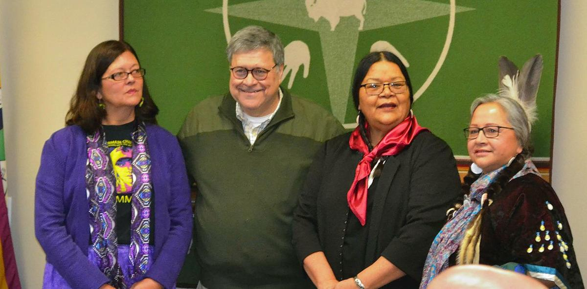 Three members of Council stand with Barr