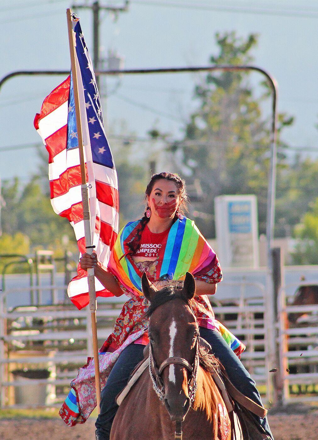 Kaina Davis present the American Flag