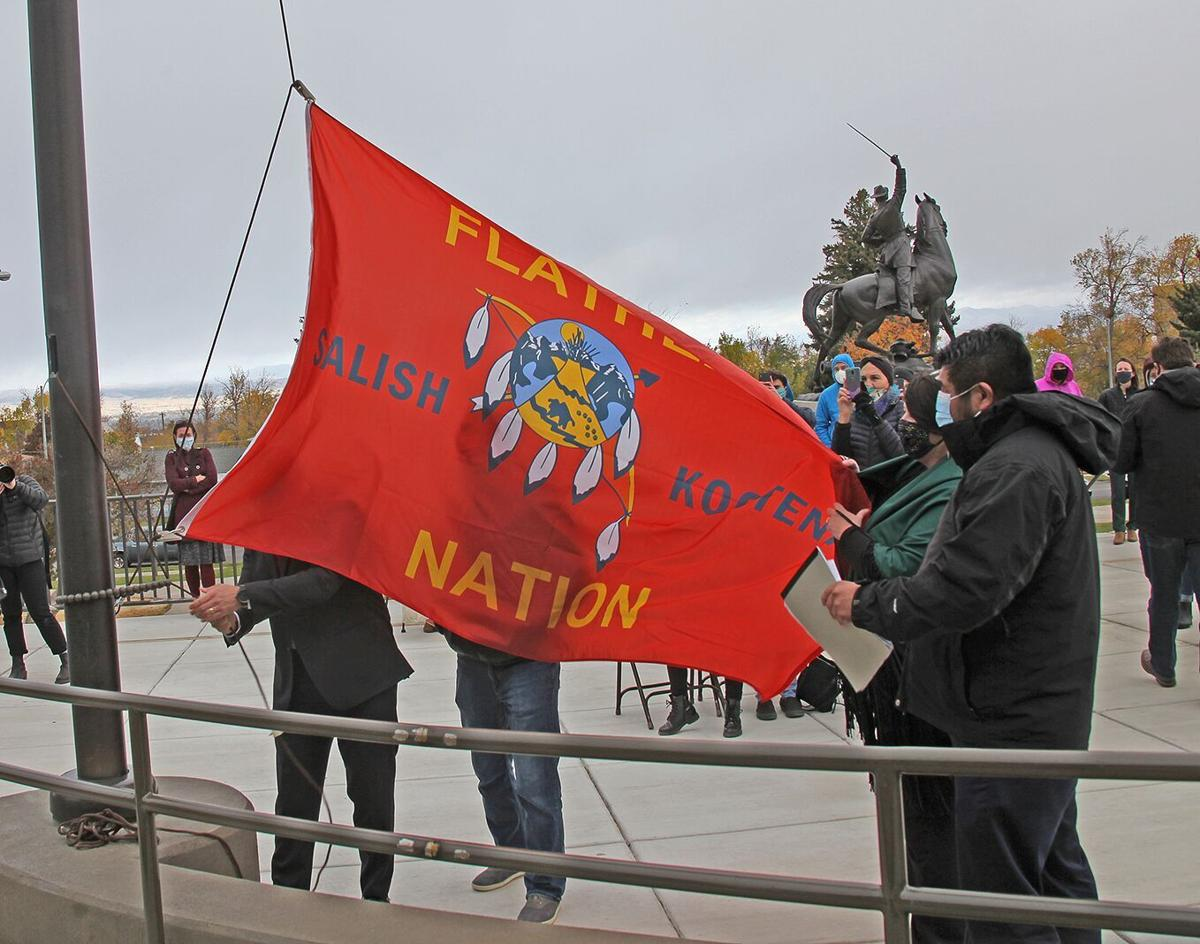 Tribal Nation flags snap to attention at the dedication of the Tribal Flag Plaza
