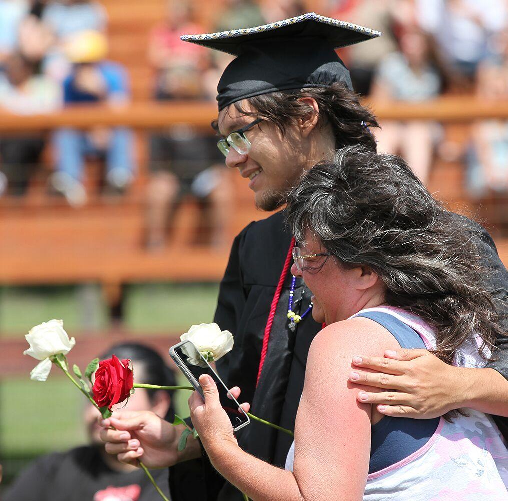 MHS Class of 2021 graduates present roses