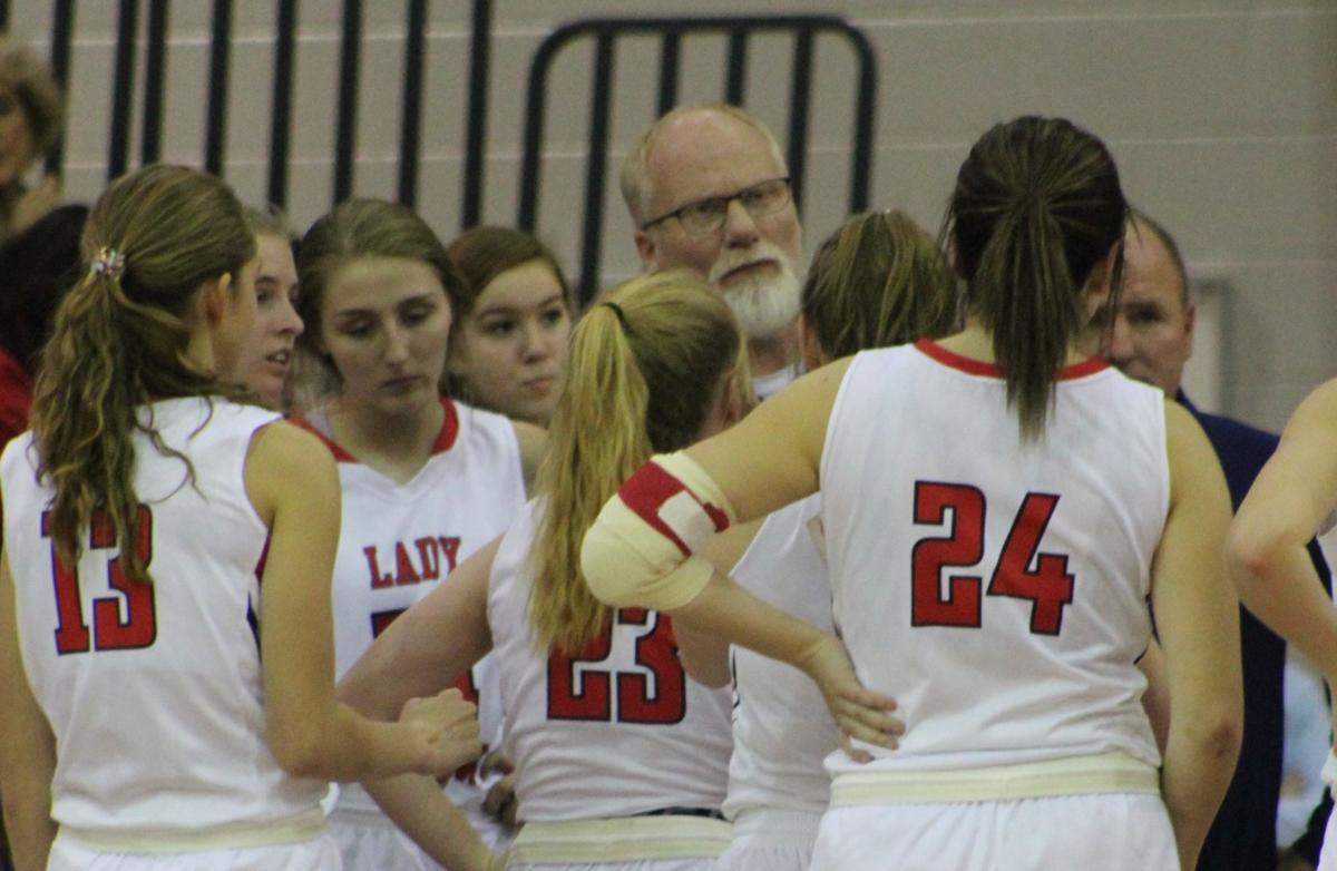Creek Wood coach Russell Wilson going over a few things with his girls during a timeout.JPG