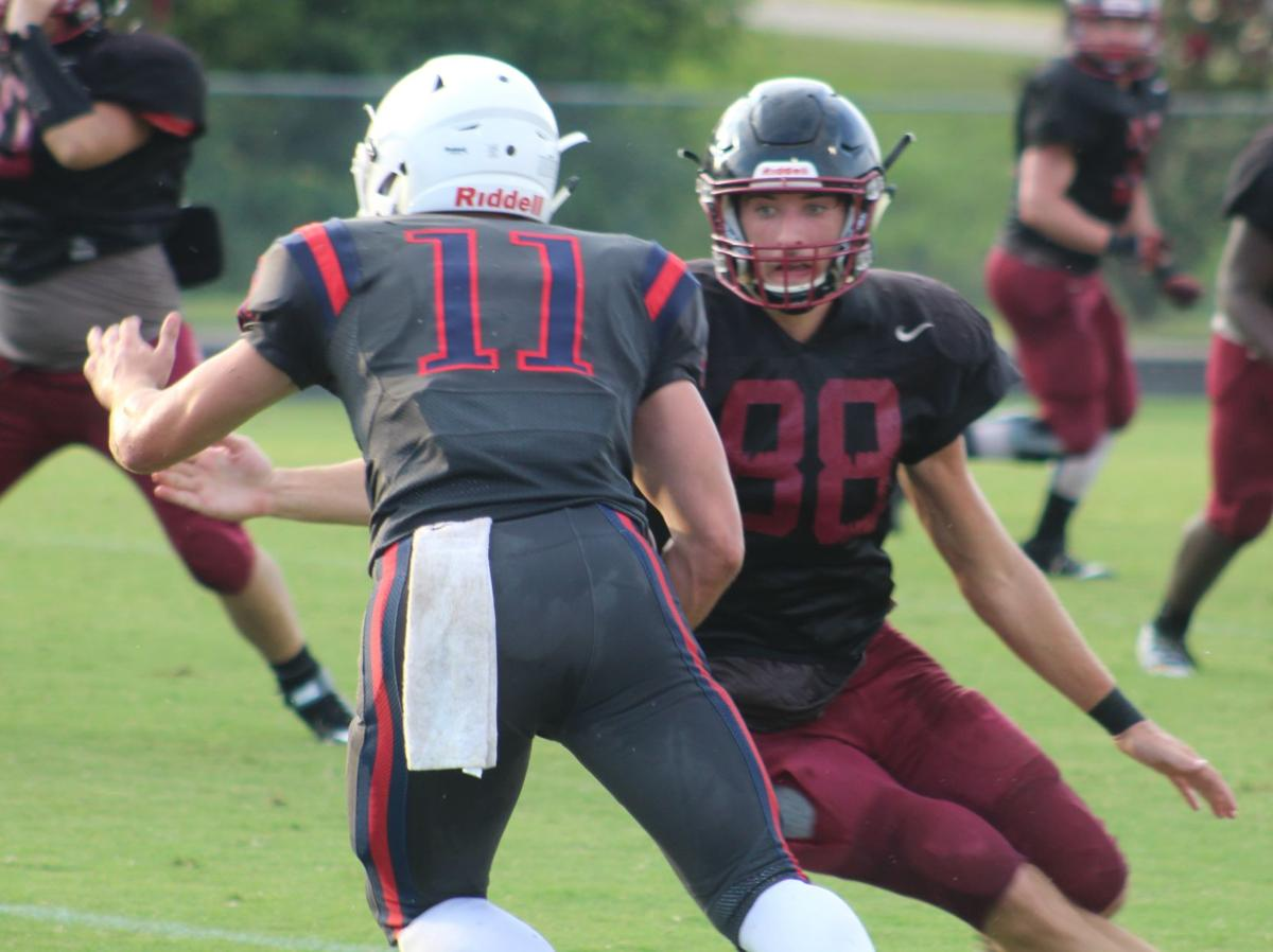 Cheatham County's Zach Kessler sets up to tackle Creek Wood's Danny Stansberry. CASEY PATRICK