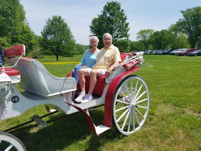 Former Cheatham County Sheriff John Holder and his wife, Wildee, get ready for a horse-drawn carriage ride at the Ashland City Senior Center picnic in Riverbluff Park last week. RANDY MOOMAW