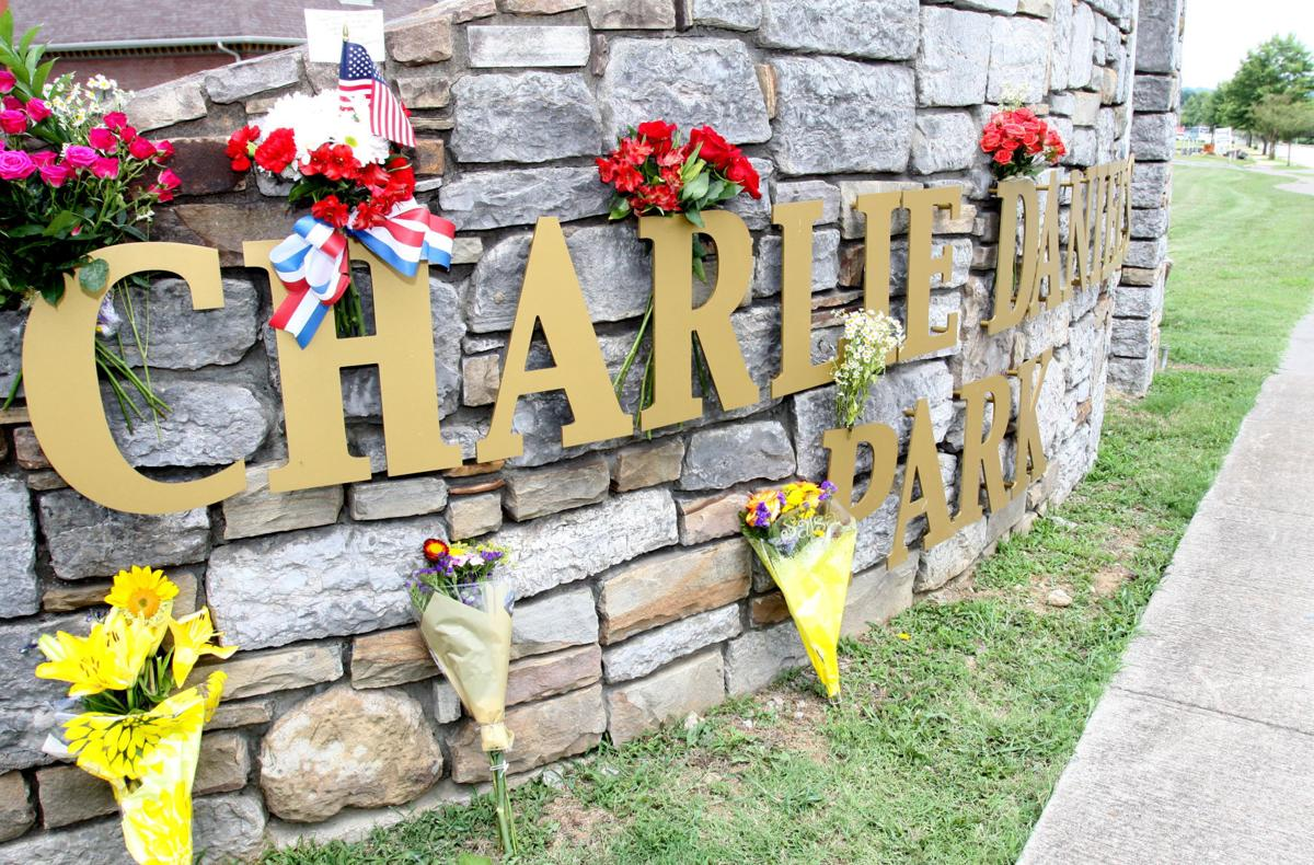 Flowers left by Charlie Daniels fans start to cover the entrance sign to Charlie Daniels Park in Mt. Juliet on Monday afternoon. The Country Music Hall of Fame singer died Monday morning. DALLUS WHITFIELD