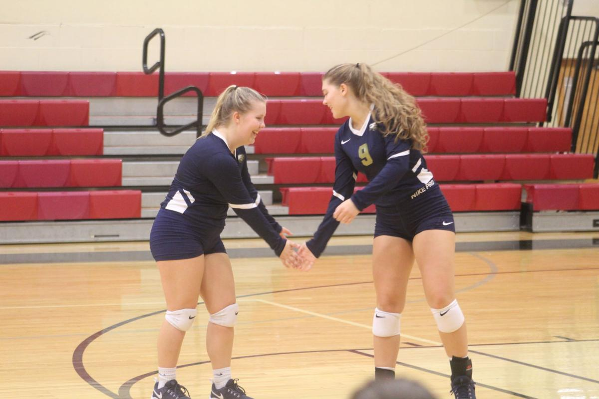 Sycamore's Ella Bailey (9) and Brylie Hoppus (2) have their own handshake after every point.JPG