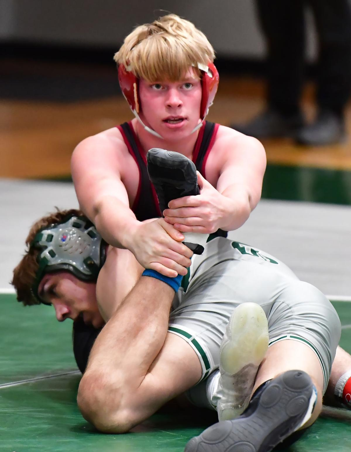 Cheatham's Timmy Kern holds the foot of Greenbrier's Elliot Counasse during their third-place match in the 152-pound division.jpg