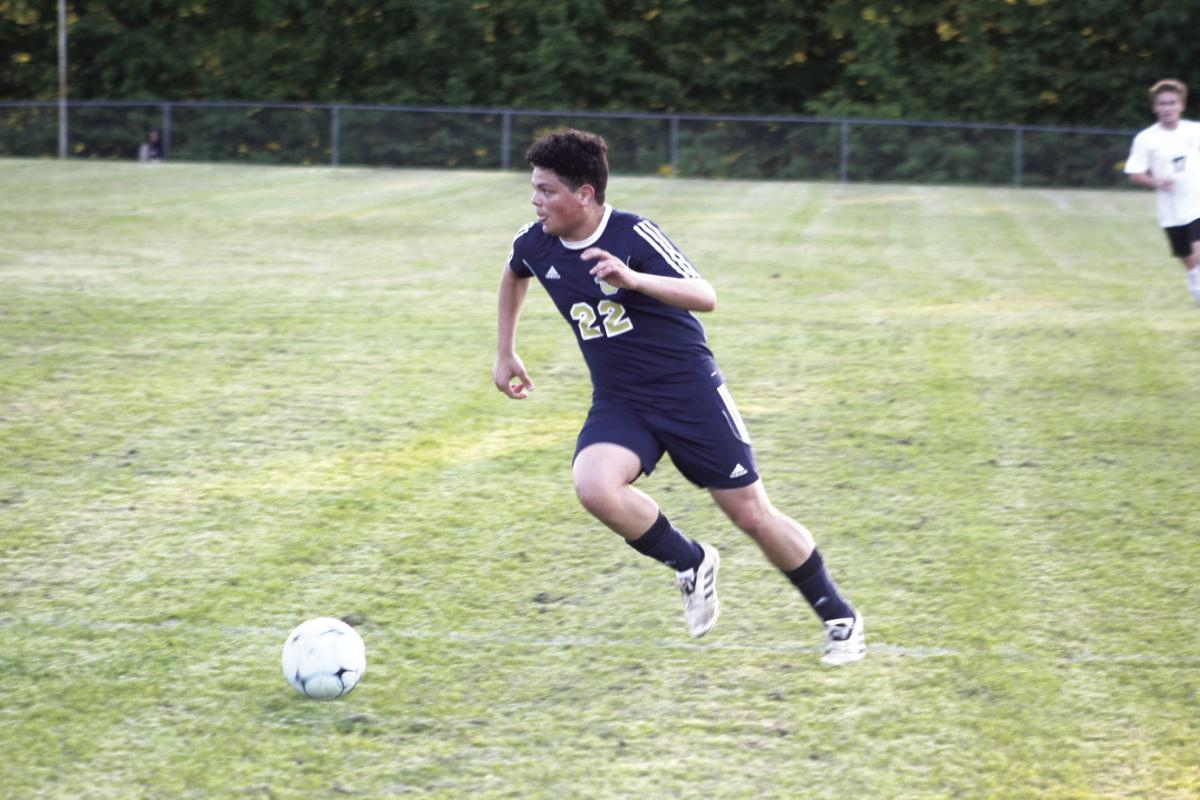 Sycamore's Diego Sing heads toward the goal in Tuesday's game against Central Magnet. CASEY PATRICK