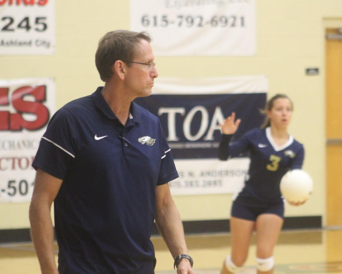 Sycamore's coach Larry Hunter watches as Gracie Parrish gets ready for the serve.JPG