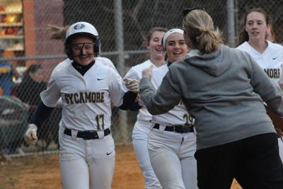 Macey Harris is gathered by her teammates after a majestic home run.JPG