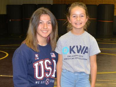 Cherokee sisters shine on wrestling mat