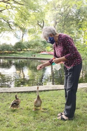 Anita Balodis feeding ducks