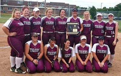The Dupo Tigers softball team (circa 2017) with their regional trophy.