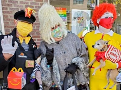 Miss Lucy Foozie, center,  will host the Lakeview Halloween Pup Crawl on Saturday, October 23.