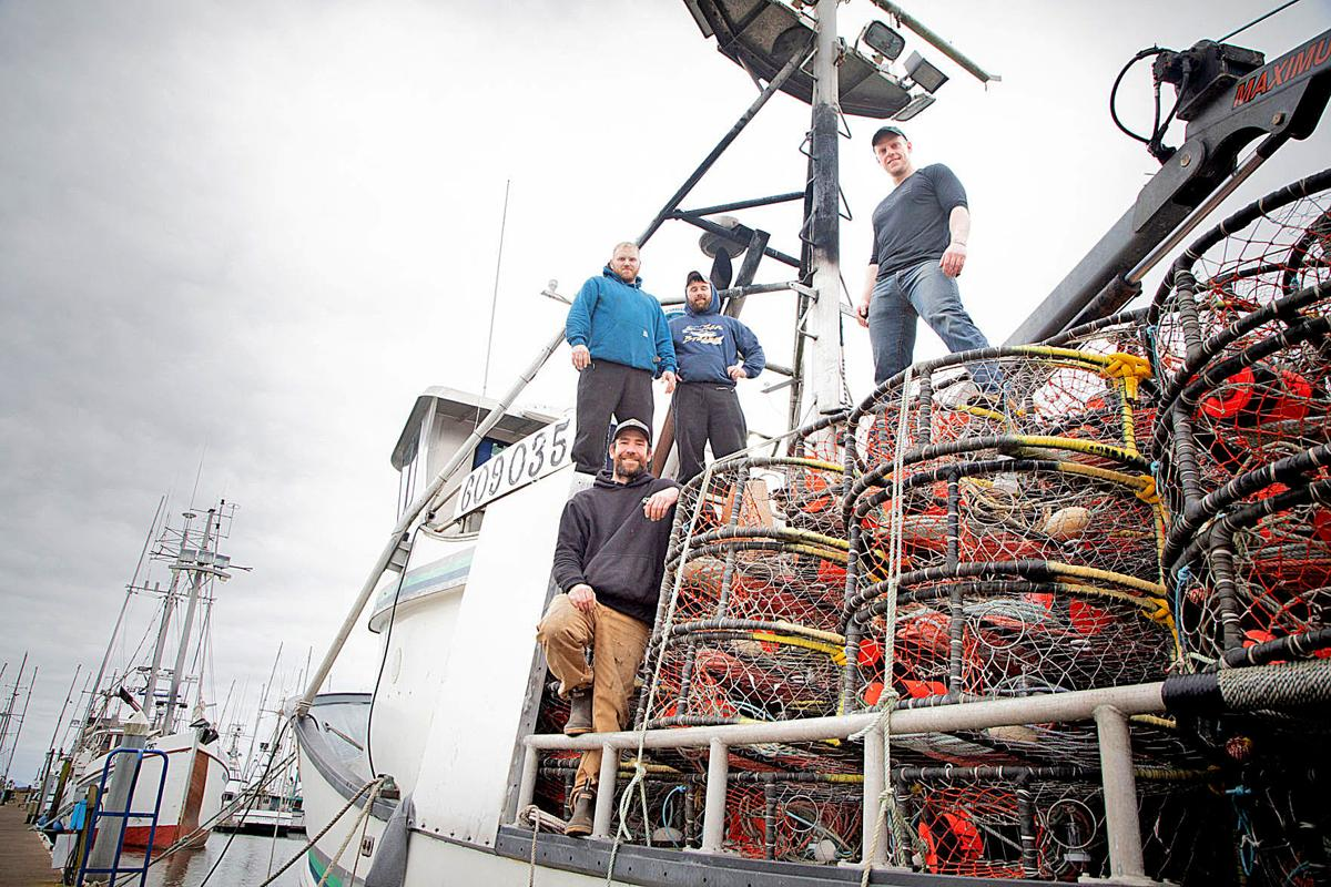 Crew of the F/V Amanda C pose for a picture atop their load of crab pots