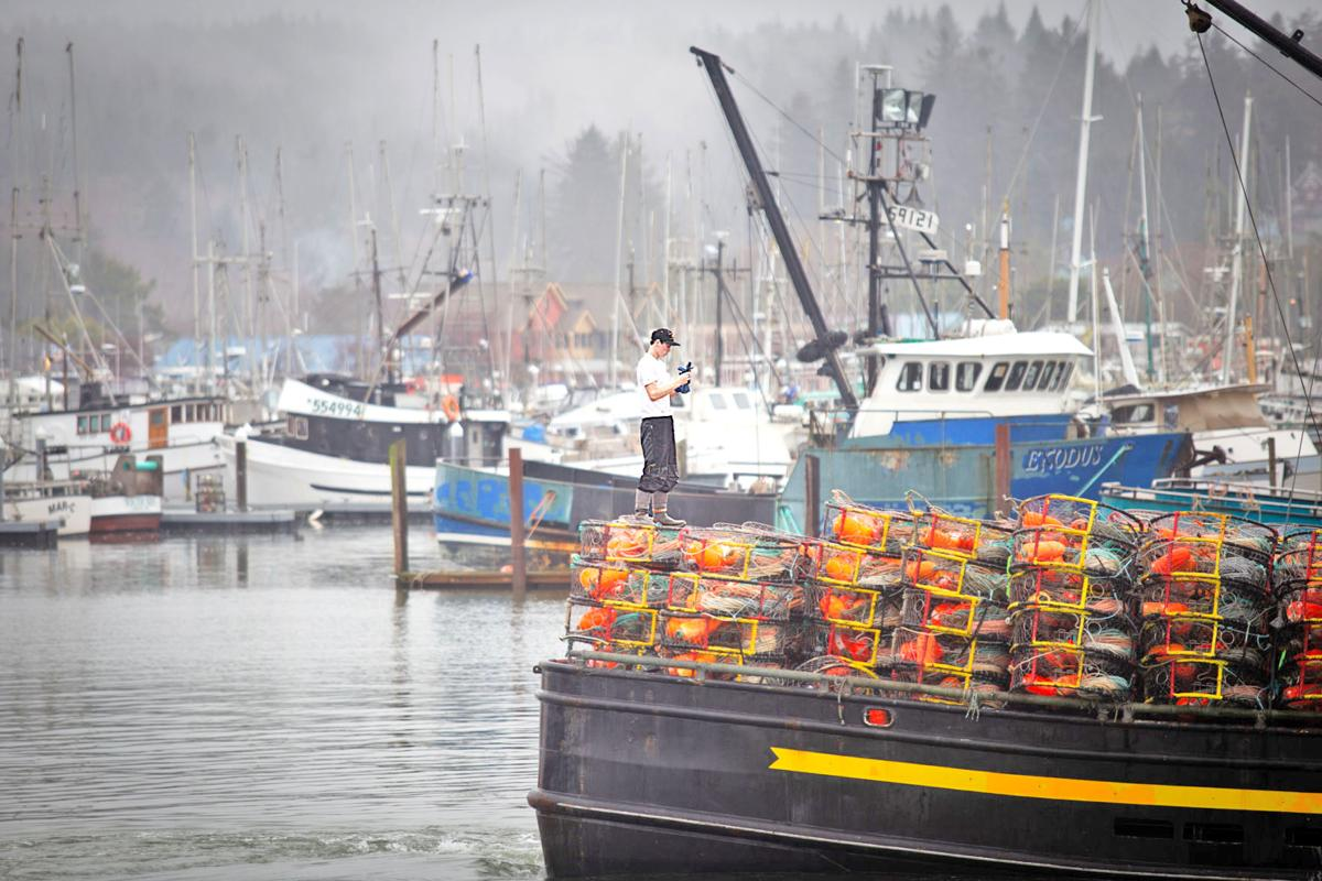 Jonathan Kingslend of the F/V Chandalar slips on gloves as they prepare to head to sea
