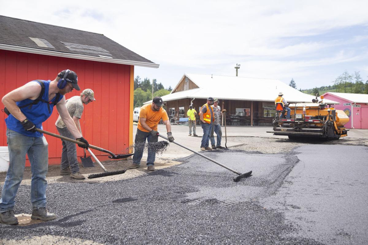 Crew from Naselle Rock and Asphalt Company raked, shoveled and paved under a glaring afternoon sun