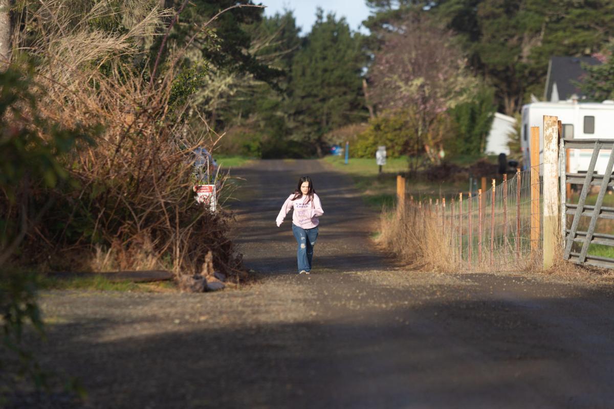 Martin walks down her driveway to greet bus drivers