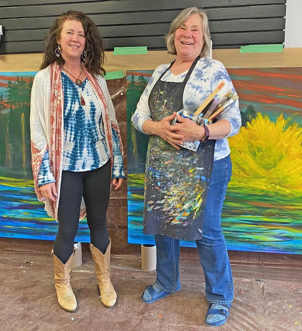 Shelley Ausmus stands with artist Bette Lu Krause
