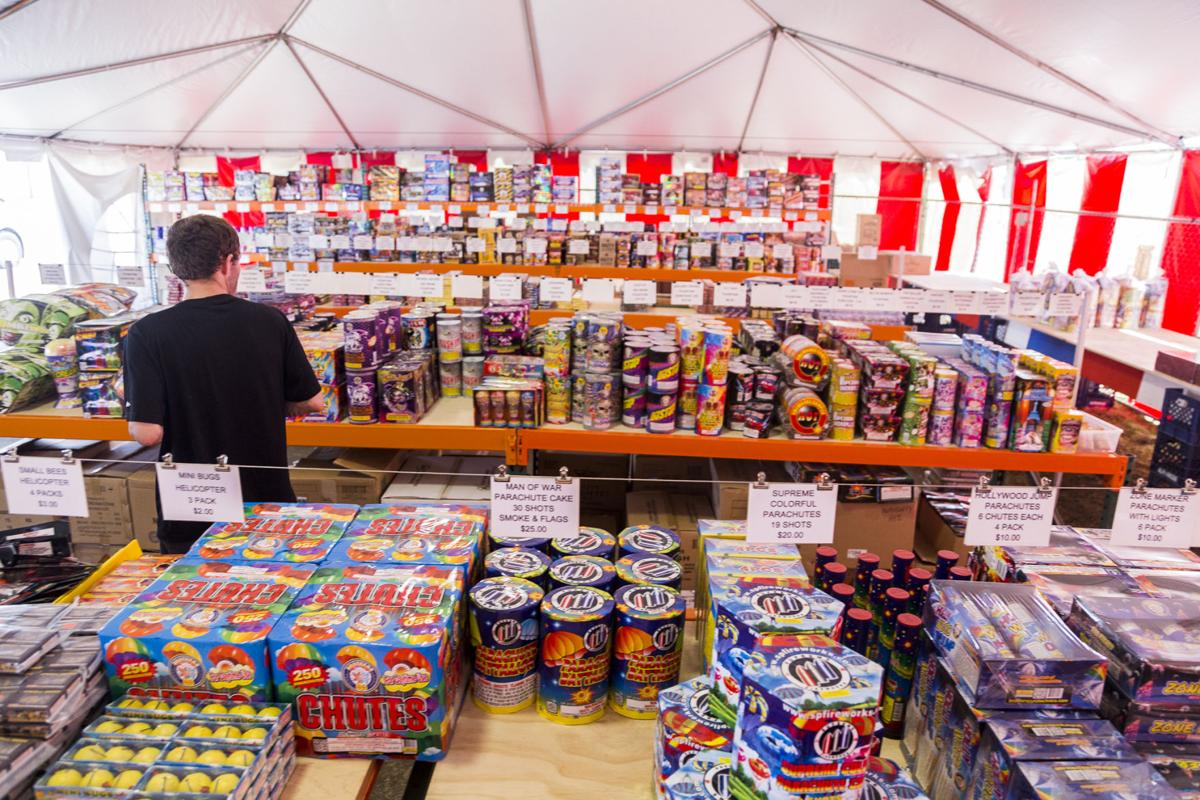A customer browses the selection available at Jack Marsh's firework stand in Chinook