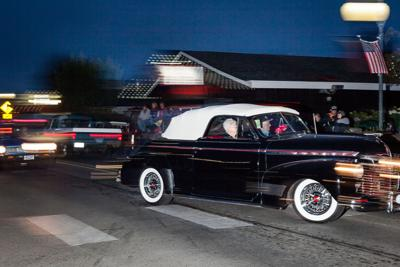 Lovingly restored vintage auto cruised through downtown Long Beach