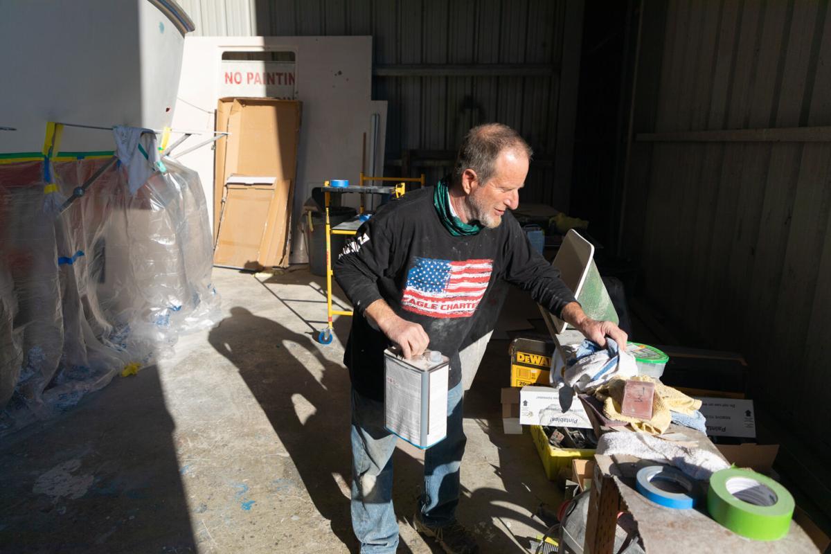 Todd Holt gathers supplies