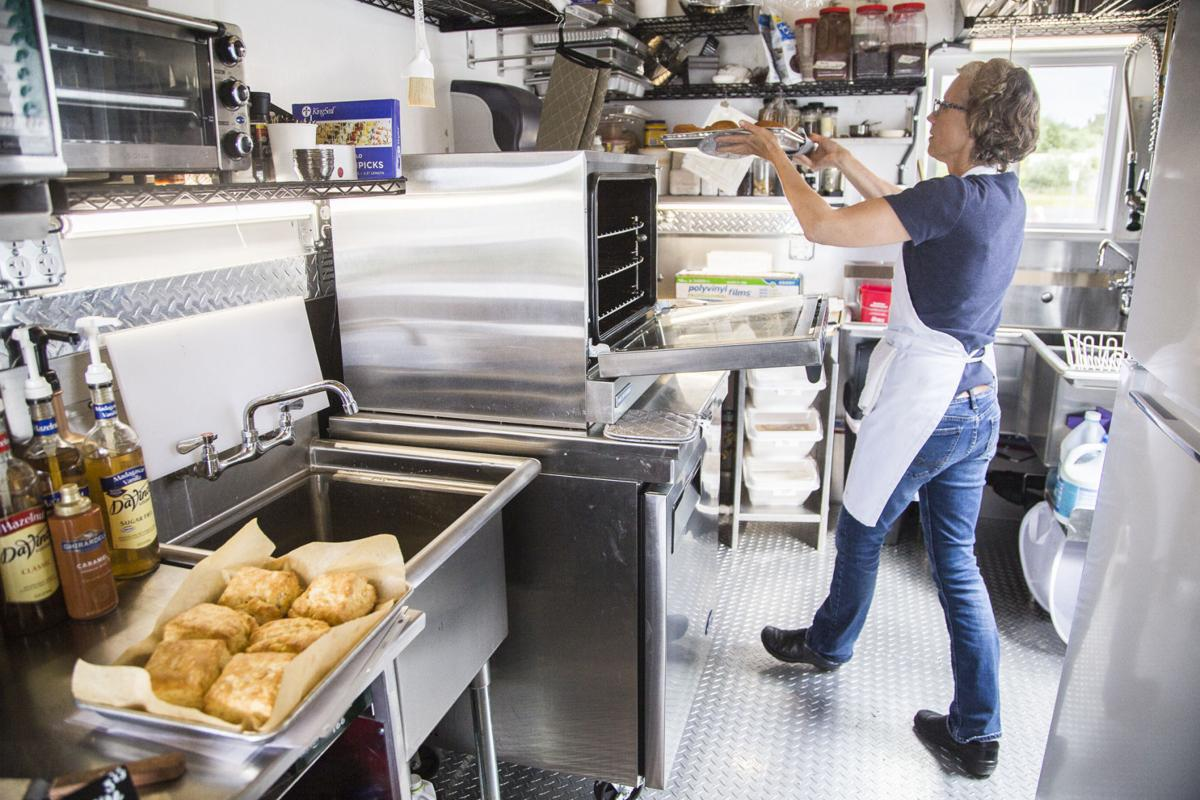 Perkins prepares fresh-baked biscuits and rolls inside her food-cart sized bakery daily