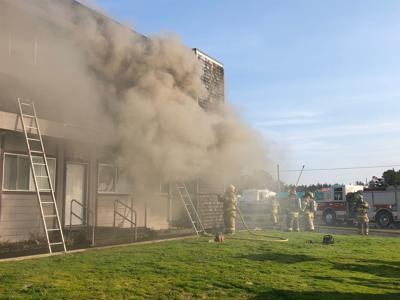 Additional equipment and manpower arrive at Long Beach apartment fire