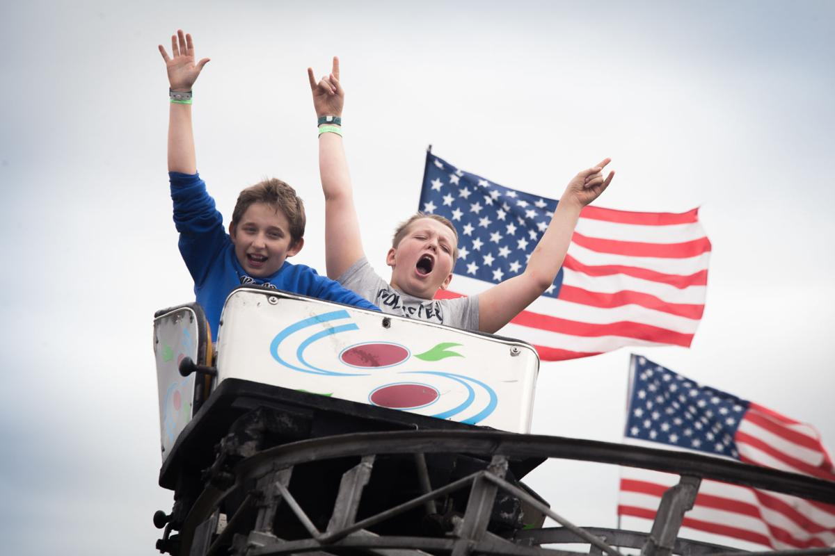 Cody Strocyk, 13, and Aiden Sliva, 13, both of Raymond, ride a rollercoaster Thursday, Aug. 22 at the Pacific County Fair