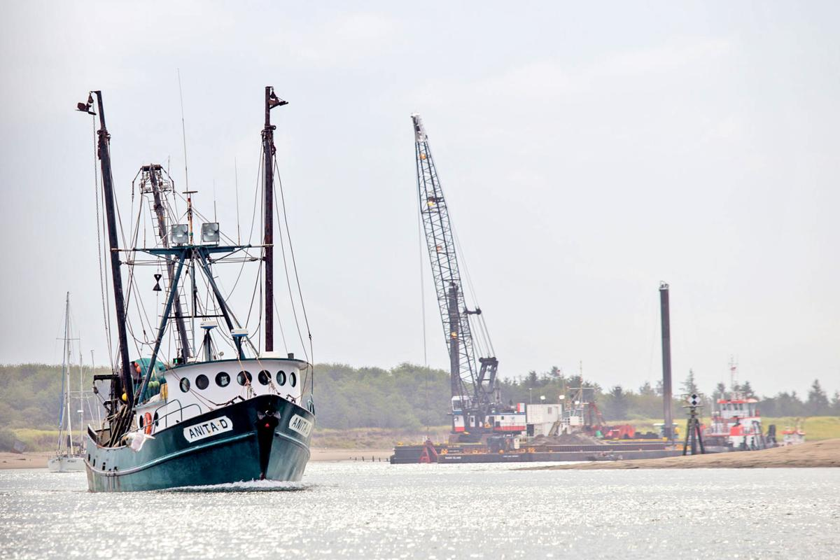 The F/V Anita D heads toward the Port of Ilwaco to offload as dredge work continues in the Ilwaco Channel in late August