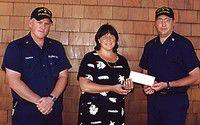 Coast Guard raises $1,300 to help fund Education Foundation dinner-auction