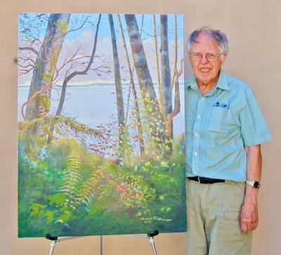 Charles Funk stands with his painting