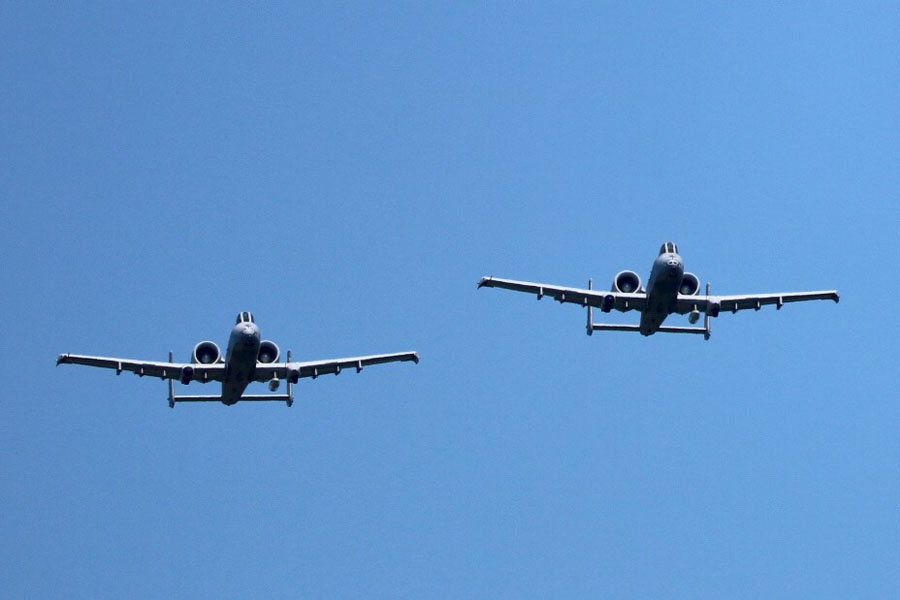 Air Force A10s fly over Loyalty Day parade