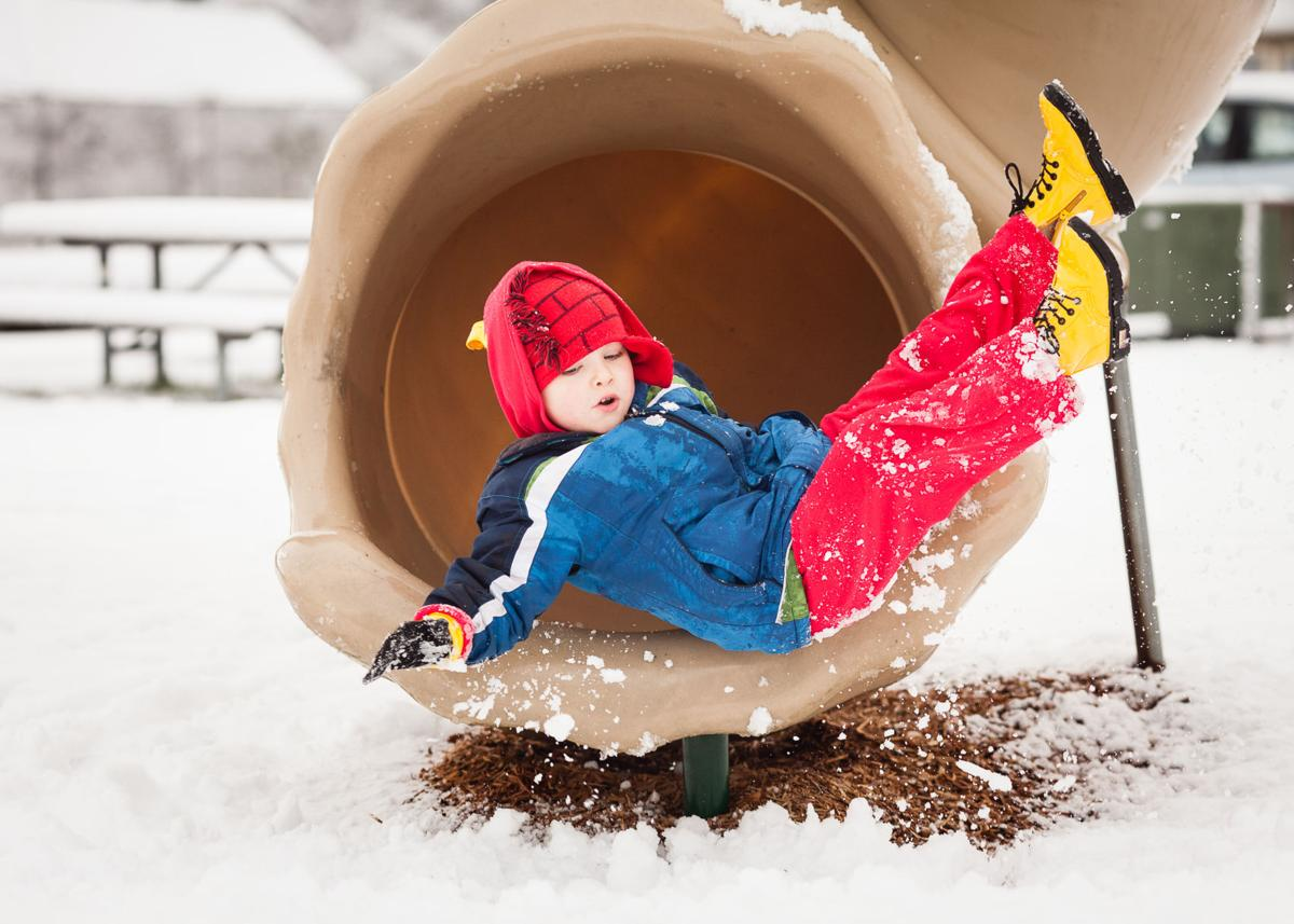 Icy weather made for an extra slippery slide at Culbertson Park in Long Beach, but Noah Cole made a soft landing in a pile of snow.
