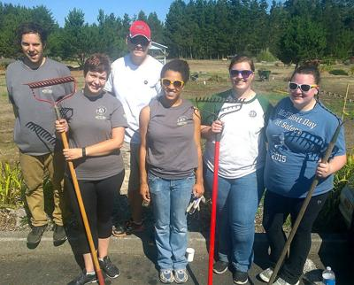 Americorps volunteers dig into projects